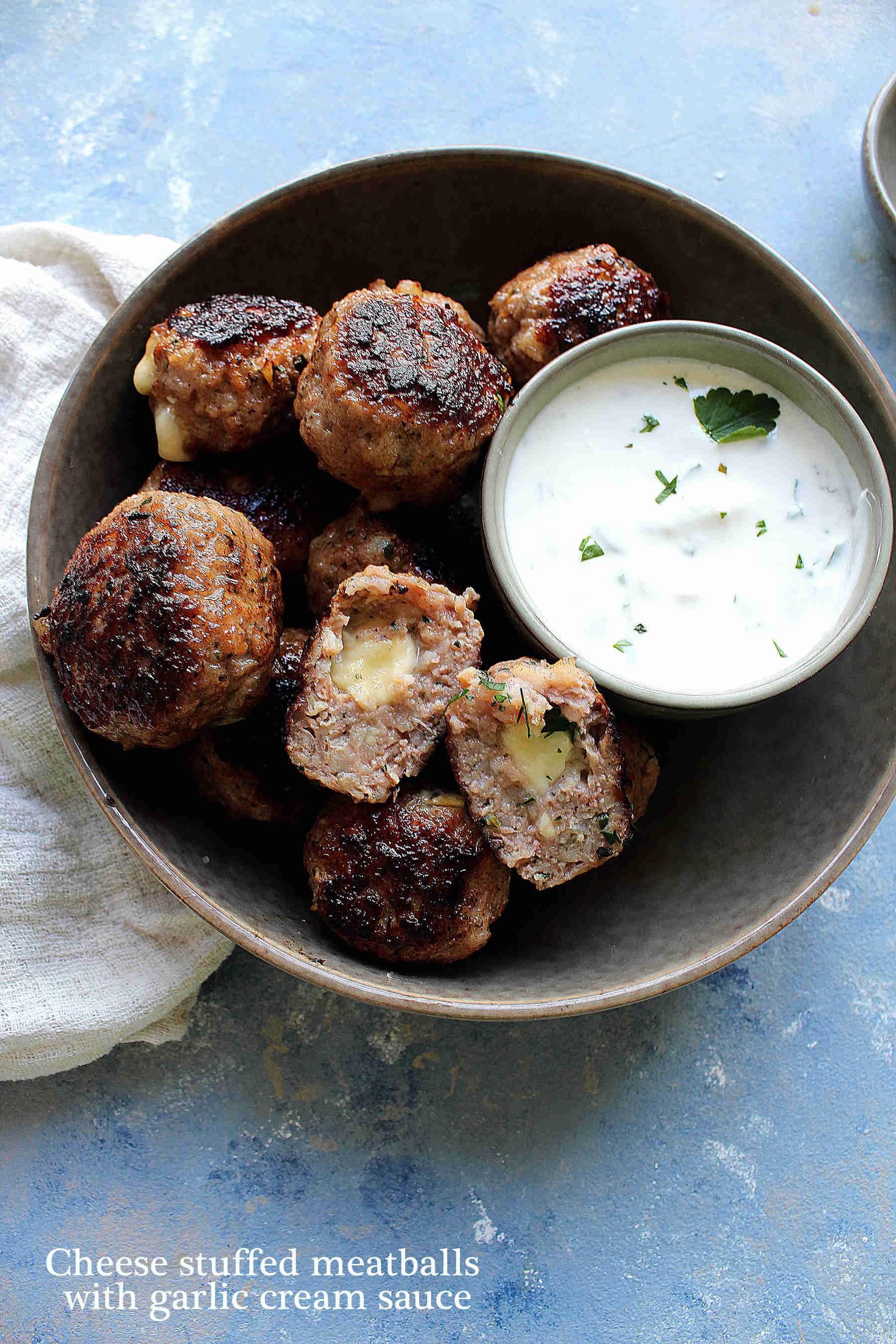 Cheese stuffed meatballs with garlic cream sauce