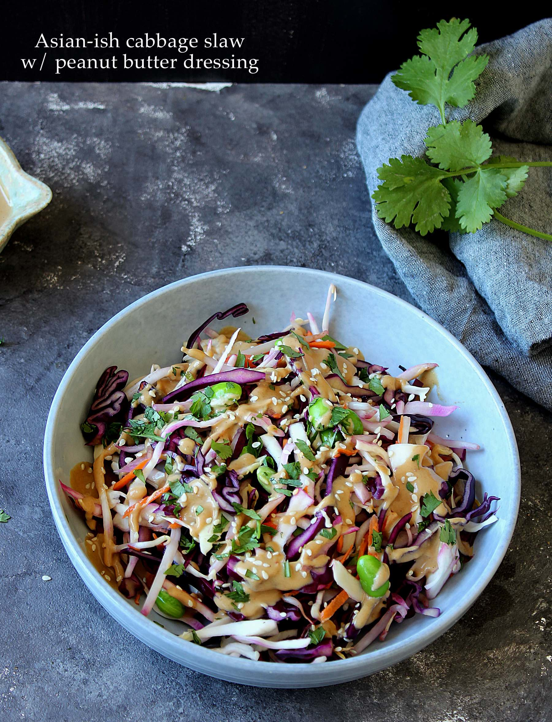Colorful asian inspired cabbage salad with peanut butter dressing