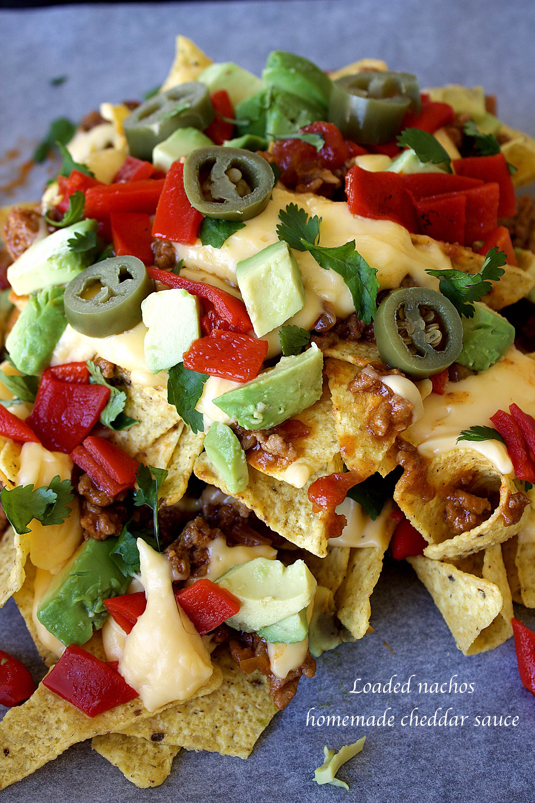 Loaded nachos with homemade cheddar sauce